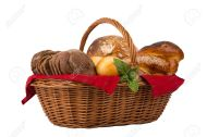 Bread and buns in wicker basket isolated on white