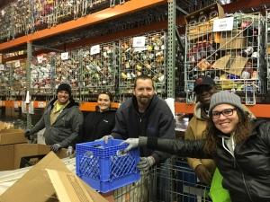 Ogden employees, Chad Larsen, December Cope, Joe TenEyck, Benjamin Apponsah, and Rebecca Neris assemble food baskets at CCS Joyce Hansen Hall Food Bank. (www.compassminerals.com)