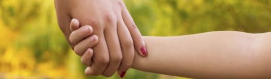 iStock_Safety_Child__Adult_holding_hands_27242288_Medium