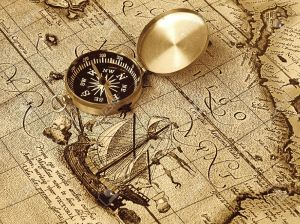 12686383-A-compass-lies-on-an-age-old-map-Stock-Photo-pirate