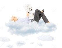 young-blond-female-reading-newspaper-lying-clouds-isolated-white-background-34633552