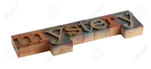 7273501-the-word-mystery-in-vintage-wooden-letterpress-type-blocks-stained-by-color-ink-isolated-on-white-stock-photo
